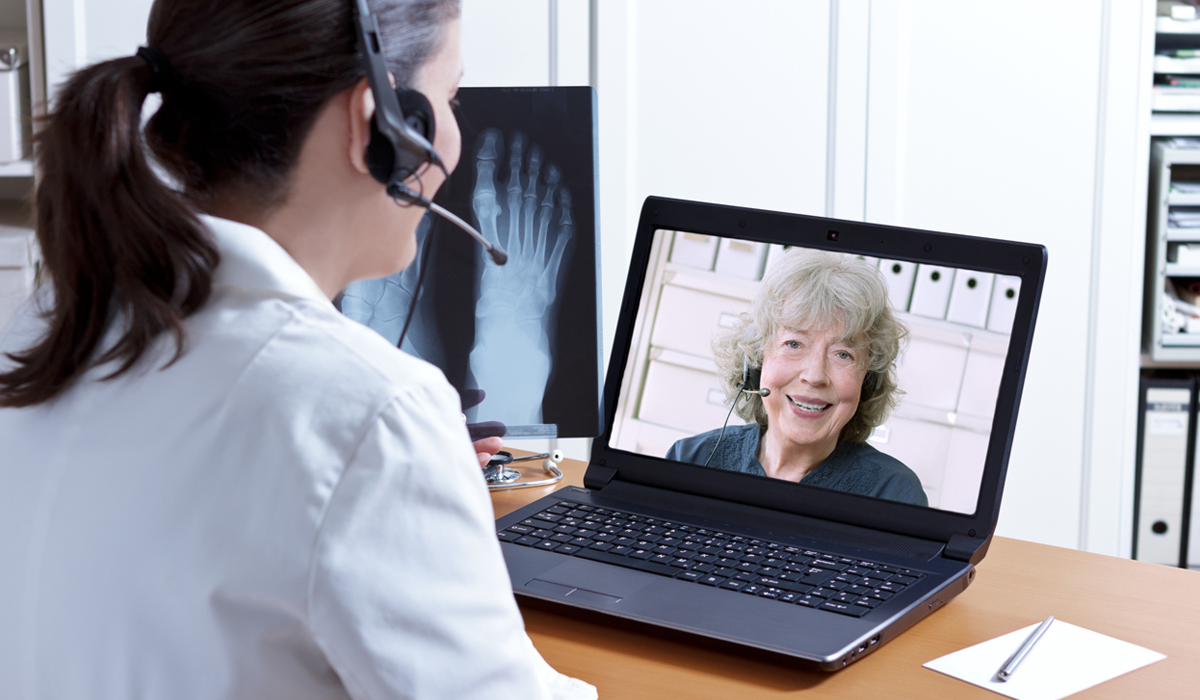 female-doctor-chatting-with-patient-over-web-conference