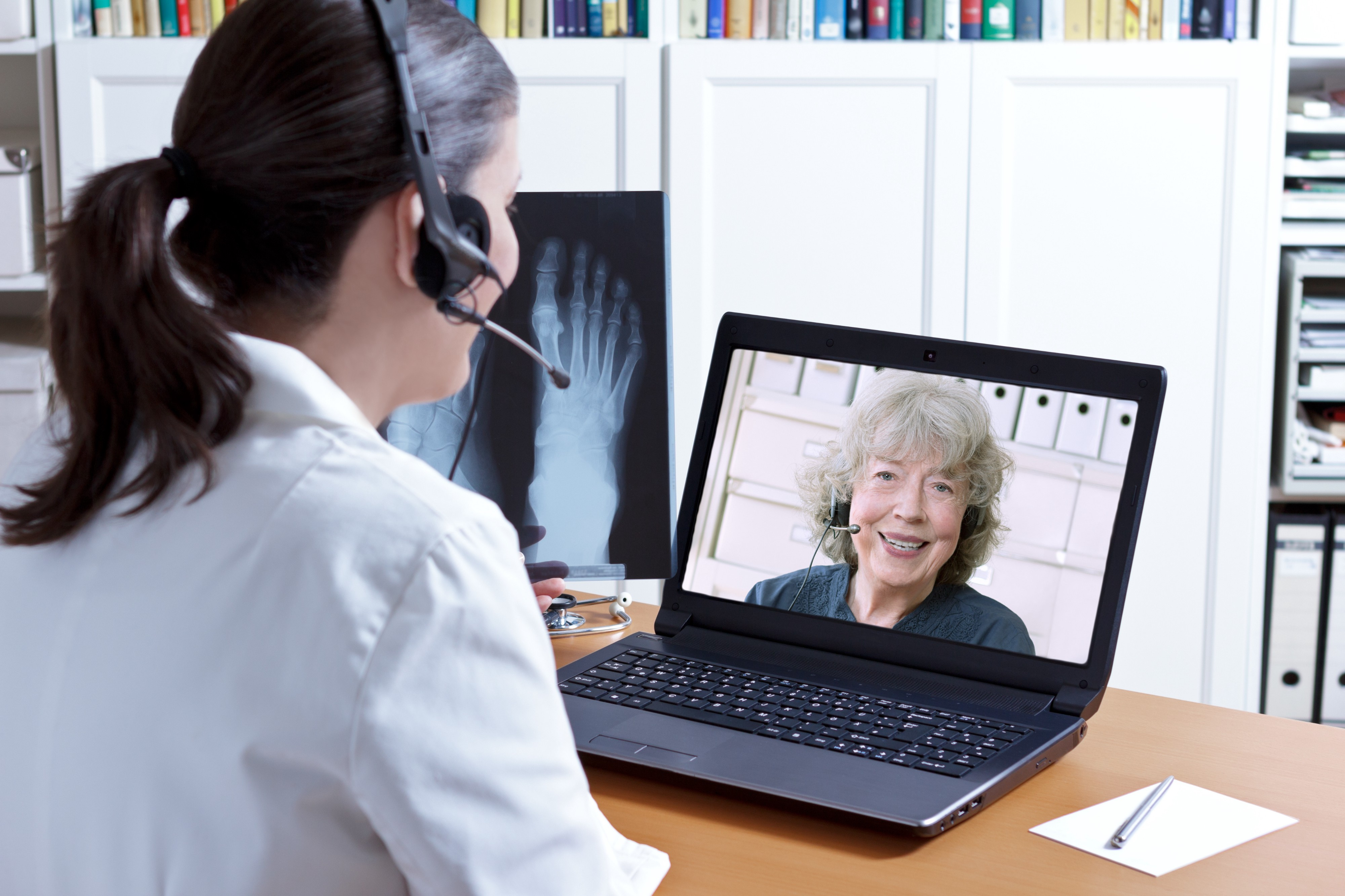 Doctor chatting with patient on laptop
