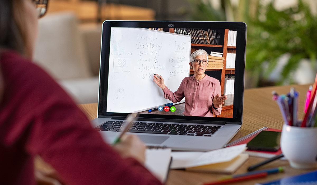 student watching teacher on laptop