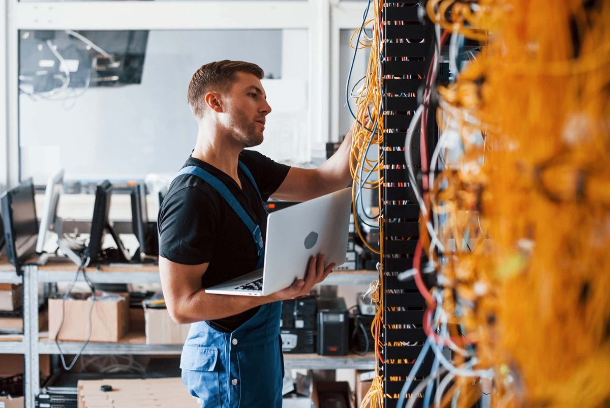 man setting up network cables