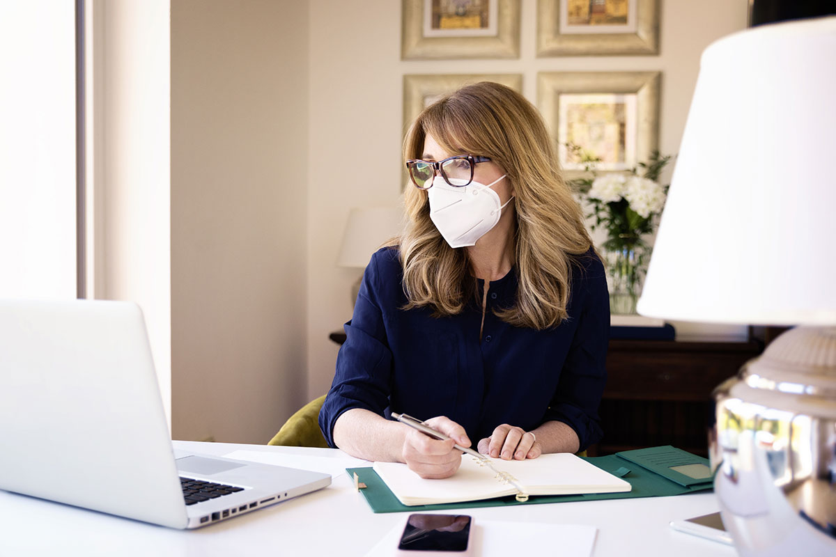 woman-wearing-mask-while-working-at-home