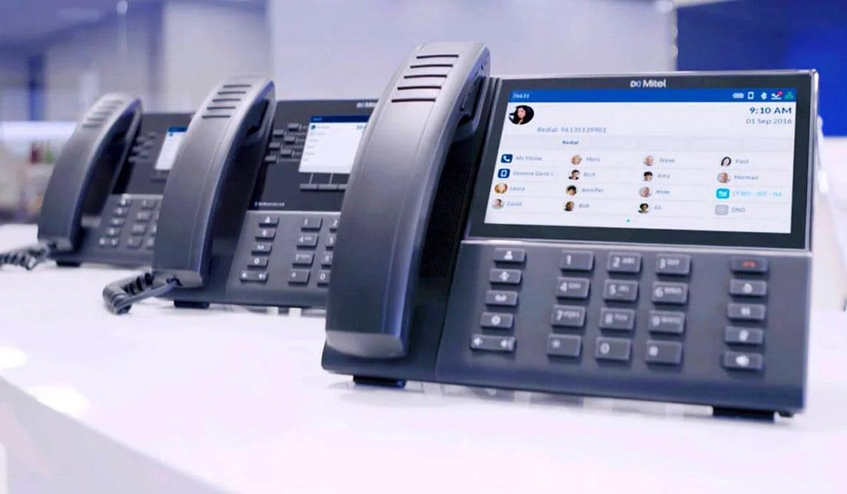 row of mitel phones on desk