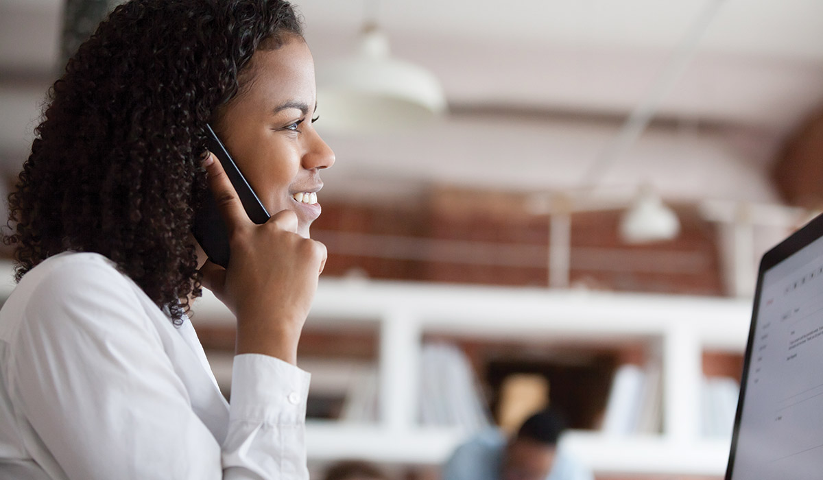 woman on phone in office setting